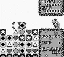 In game image of Tetris Attack on the Nintendo Game Boy.