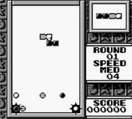 In game image of Tetris Flash on the Nintendo Game Boy.