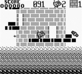In game image of Tower Toppler on the Nintendo Game Boy.