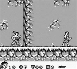 In game image of Turok: Battle of the Bionosaurs on the Nintendo Game Boy.