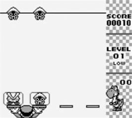 In game image of Yoshi on the Nintendo Game Boy.