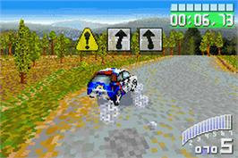 In game image of Colin McRae Rally 2.0 on the Nintendo Game Boy Advance.