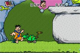 In game image of Flintstones: Big Trouble in Bedrock on the Nintendo Game Boy Advance.