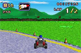 In game image of LEGO Racers 2 on the Nintendo Game Boy Advance.