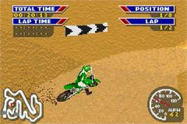 In game image of MX 2002 featuring Ricky Carmichael on the Nintendo Game Boy Advance.