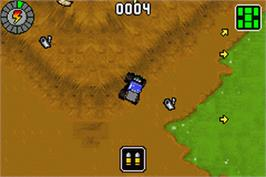 In game image of Monster Jam: Maximum Destruction on the Nintendo Game Boy Advance.