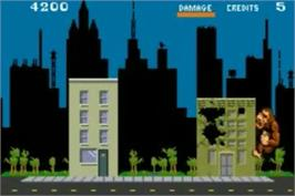 In game image of Paperboy / Rampage on the Nintendo Game Boy Advance.