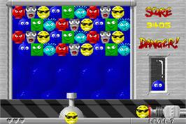 In game image of Snood on the Nintendo Game Boy Advance.