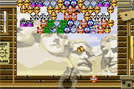 In game image of Snood 2: On Vacation on the Nintendo Game Boy Advance.