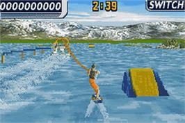 In game image of Wakeboarding Unleashed featuring Shaun Murray on the Nintendo Game Boy Advance.
