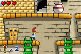 In game image of Woody Woodpecker in Crazy Castle 5 on the Nintendo Game Boy Advance.