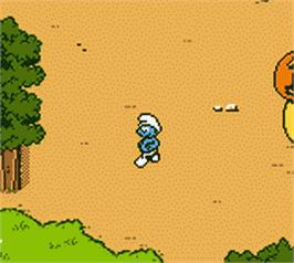 In game image of Adventures of the Smurfs on the Nintendo Game Boy Color.