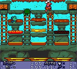 In game image of Flintstones: Burgertime in Bedrock on the Nintendo Game Boy Color.