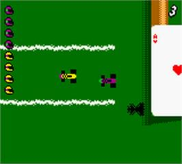 In game image of Micro Machines V3 on the Nintendo Game Boy Color.