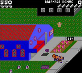 In game image of Paperboy on the Nintendo Game Boy Color.