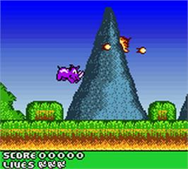 In game image of Rhino Rumble on the Nintendo Game Boy Color.