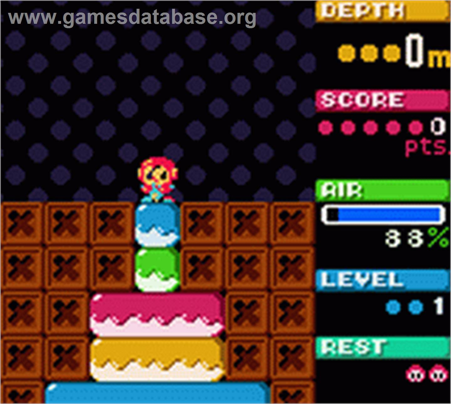 In game image of Mr Driller on the Nintendo Game Boy Color.