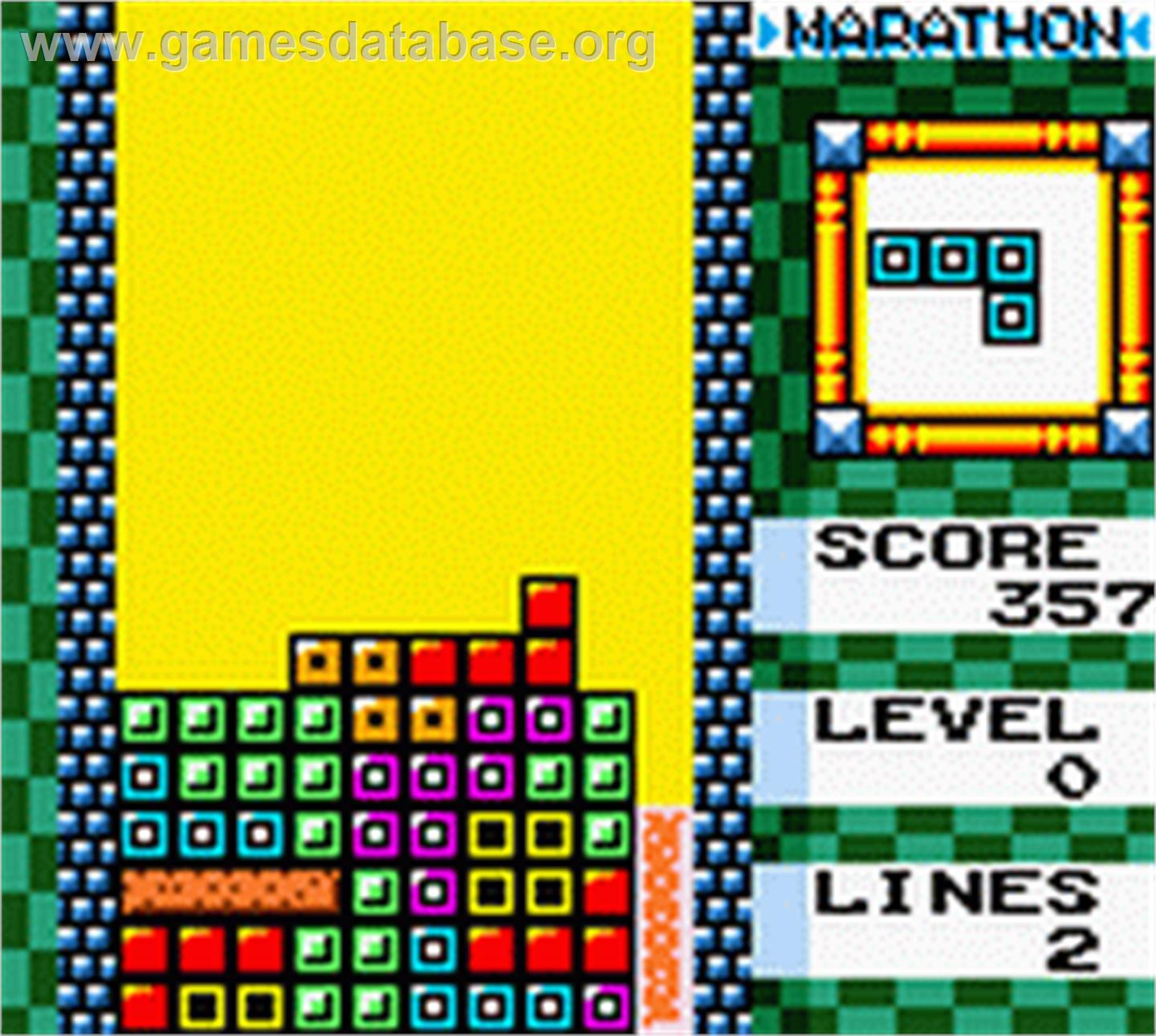In game image of Tetris DX on the Nintendo Game Boy Color.