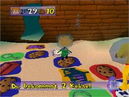 In game image of Rugrats: Die grosse Schatzsuche on the Nintendo N64.