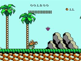 In game image of Adventure Island 3 on the Nintendo NES.