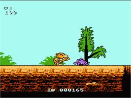 In game image of Big Nose the Caveman on the Nintendo NES.