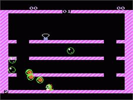In game image of Bubble Bobble on the Nintendo NES.
