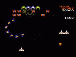 In game image of Galaga on the Nintendo NES.