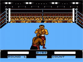 In game image of George Foreman's KO Boxing on the Nintendo NES.