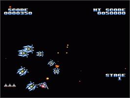 In game image of Gyruss on the Nintendo NES.