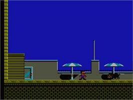 In game image of Hudson Hawk on the Nintendo NES.