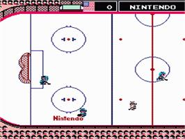 In game image of Ice Hockey on the Nintendo NES.