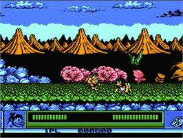 In game image of Joe & Mac: Caveman Ninja on the Nintendo NES.