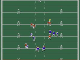 In game image of John Elway's Quarterback on the Nintendo NES.
