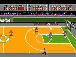 In game image of Magic Johnson's Fast Break on the Nintendo NES.