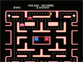 In game image of Ms. Pac-Man on the Nintendo NES.