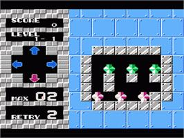 In game image of Puzznic on the Nintendo NES.