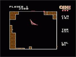 In game image of Qix on the Nintendo NES.