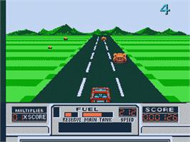 In game image of Road Blasters on the Nintendo NES.