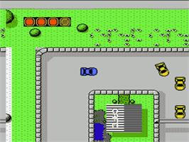 In game image of Super Cars on the Nintendo NES.