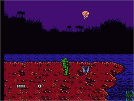 In game image of Swamp Thing on the Nintendo NES.