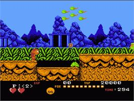 In game image of Toki: Going Ape Spit on the Nintendo NES.