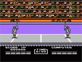 In game image of Track & Field 2 on the Nintendo NES.