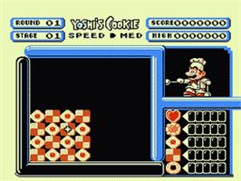 In game image of Yoshi's Cookie on the Nintendo NES.