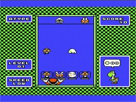 In game image of Yoshi on the Nintendo NES.
