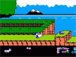 In game image of Yume Penguin Monogatari on the Nintendo NES.