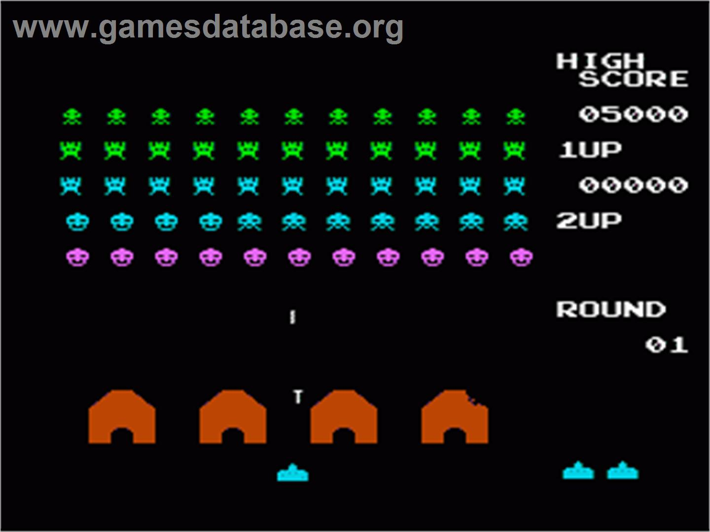 In game image of Space Invaders on the Nintendo NES.