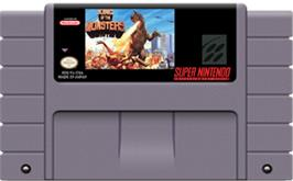 Cartridge artwork for King of the Monsters on the Nintendo SNES.