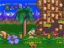 In game image of Joe & Mac 2: Lost in the Tropics on the Nintendo SNES.