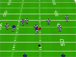 In game image of John Madden Football on the Nintendo SNES.