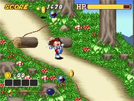 In game image of Kid Klown in Crazy Chase on the Nintendo SNES.